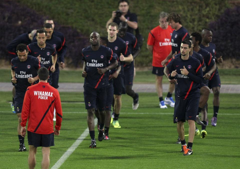 Paris Saint Germain (PSG) players attend a training session in Doha, Monday Jan. 2, 2012, ahead of their soccer match against AC Milan in Dubai on January 4. (AP Photo/Osama Faisal)