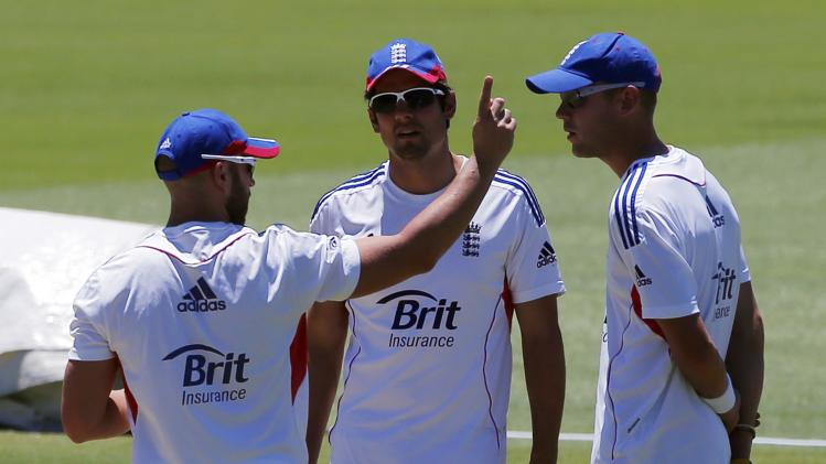 England's captain Cook listens to team-mate Prior talk with Broad as they stand near the pitch at the WACA ground in Perth