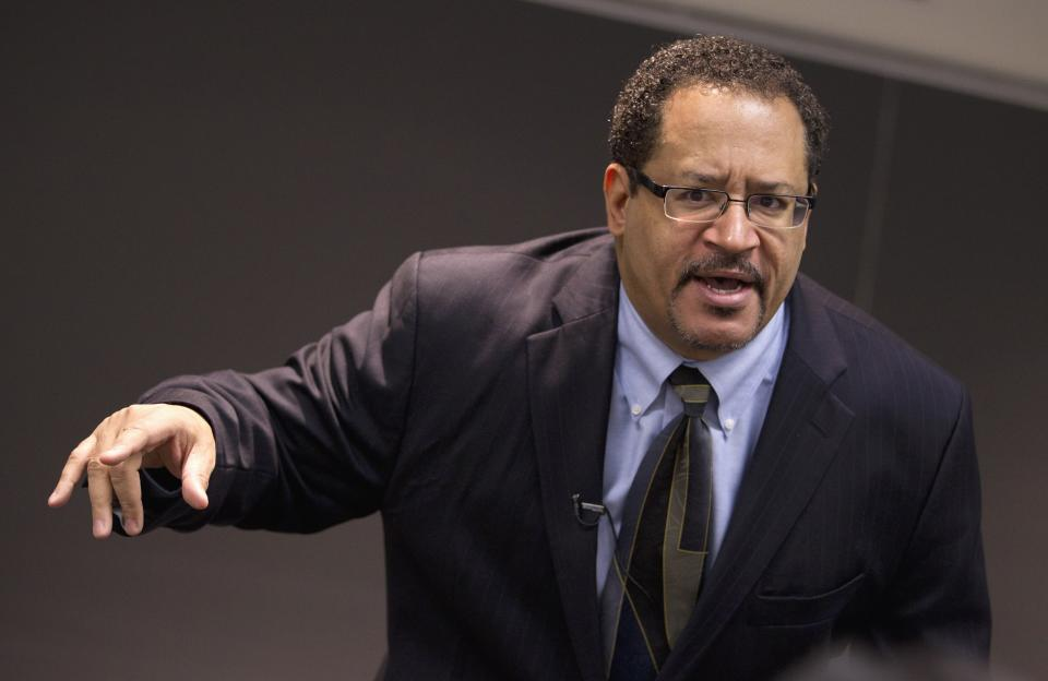 Professor Michael Eric Dyson teaches a sociology course at Georgetown University focusing on rapper Jay-Z, Monday, Nov. 28, 2011, in Washington.   (AP Photo/Evan Vucci)