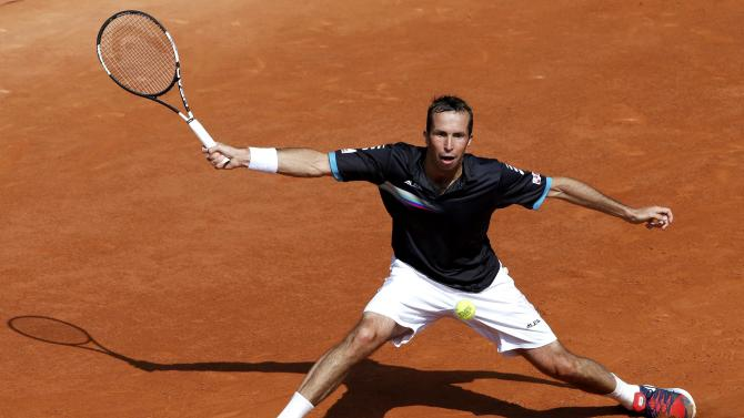 Radek Stepanek of the Czech Republic plays a shot to compatriot Tomas Berdych during their men's singles match at the French Open tennis tournament at the Roland Garros stadium in Paris