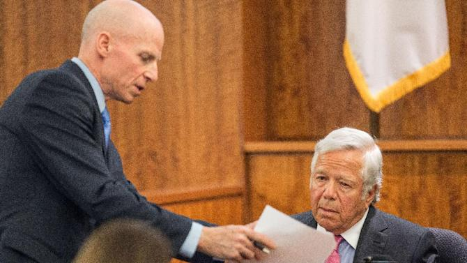 Prosecutor William McCauley, left, questions New England Patriots owner Robert Kraft as he testifies during the murder trial of former Patriots football player Aaron Hernandez, Tuesday, March 31, 2015, at Bristol County Superior Court in Fall River, Mass. Hernandez is accused of killing Odin Lloyd in June 2013.  (AP Photo/The Boston Globe, Aram Boghosian, Pool)
