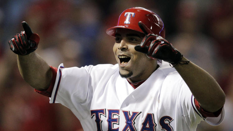 The Texas Rangers' Nelson Cruz reacts after hitting a two-run home run against the Detroit Tigers during the seventh inning at Game 6 of baseball's American League championship series Saturday, Oct. 15, 2011, in Arlington, Texas. (AP Photo/Charlie Riedel)