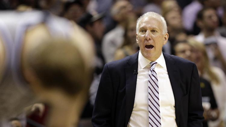 San Antonio Spurs head coach Gregg Popovich directs his team during the second half in Game 2 of the Western Conference finals NBA basketball playoff series against the Memphis Grizzlies, Tuesday, May 21, 2013, in San Antonio. (AP Photo/Eric Gay)
