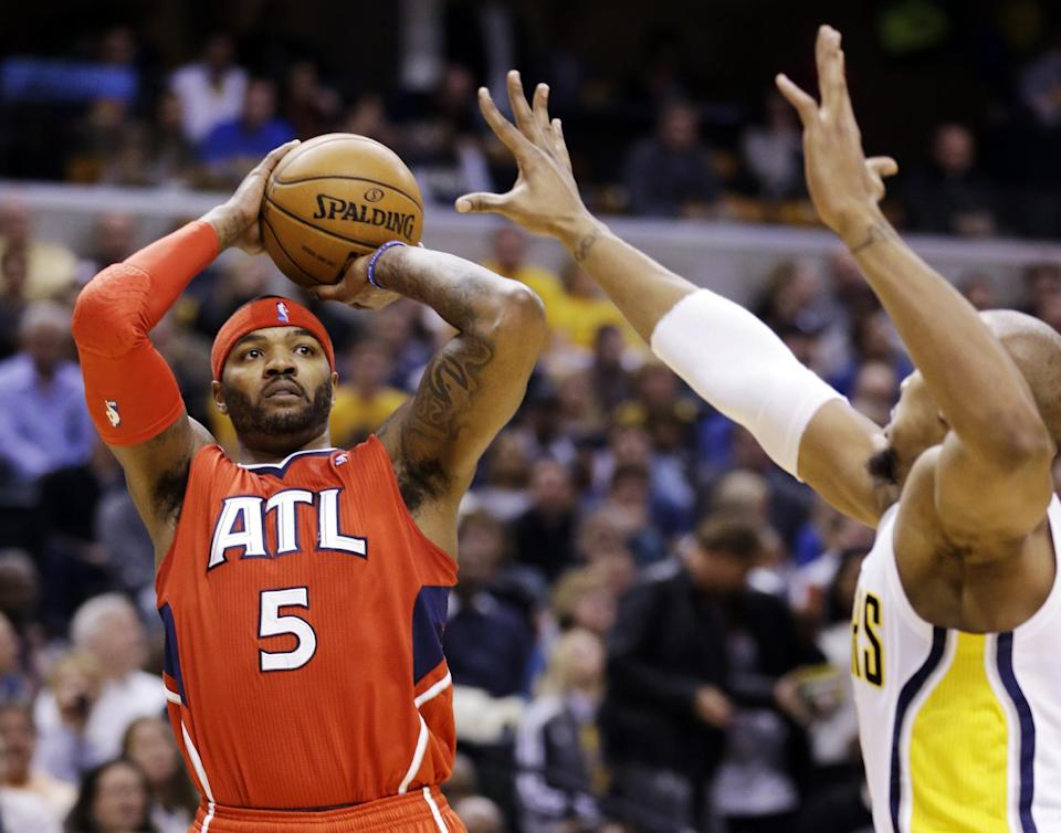 Atlanta Hawks forward Josh Smith (5) shoots over Indiana Pacers forward David West in the first half of Game 2 of a first-round NBA basketball playoff series in Indianapolis, Wednesday, April 24, 2013. (AP Photo/Michael Conroy)