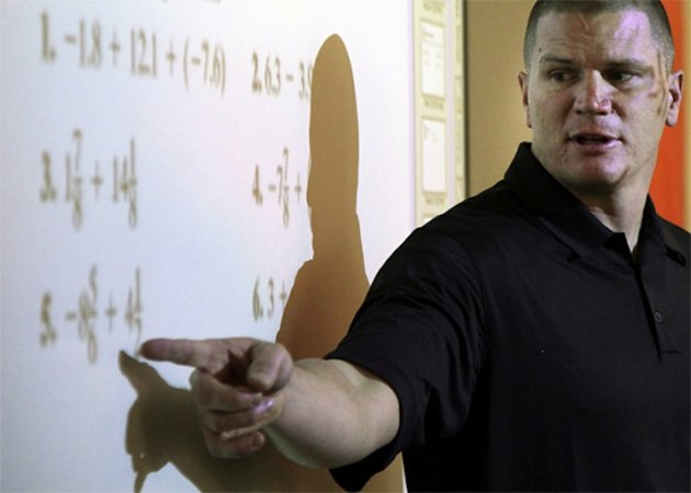 Jon Kitna will take a break from teaching a high school math class to play in the NFL -- Associated Press