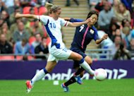Japan's forward Kozue Ando (R) vies for the ball with France's Camille Abilly during their women's football semifinal match between Japan and France at the Wembley Stadium in London, during the London 2012 Olympic Games. Japan edged closer to their dream of a rare footballing double Monday after holding off a late onslaught from France to reach the final