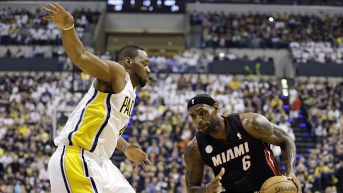 Miami Heat's LeBron James, right, is defended by Indiana Pacers' Sam Young during the first half of Game 3 of the NBA Eastern Conference basketball finals in Indianapolis, Sunday, May 26, 2013. (AP Photo/Nam H. Huh)