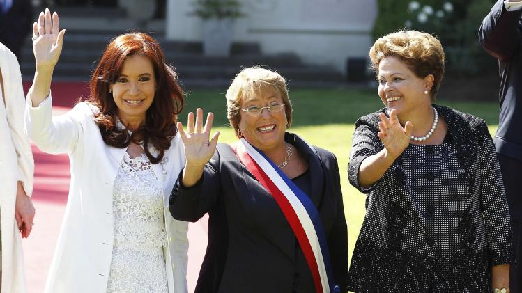 Chile's new President Bachelet poses for the media with Argentina's President Fernández de Kirchner and Brazil's president Rousseff after a meeting at Cerro Castillo Presidential Palace in Vina del Mar city