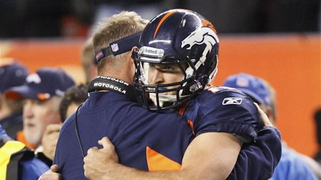 NFL Coach Mike McCoy congratulates quarterback Tim Tebow (Reuters)