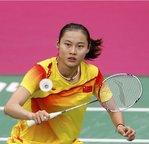 China's Yihan Wang plays against India's Saina Nehwal during their womens singles badminton semifinals match during the London 2012 Olympic Games at the Wembley Arena
