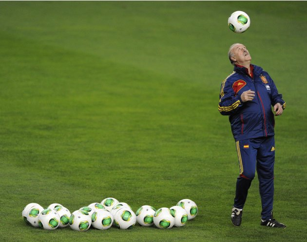 Spain's national soccer coach Vicente del Bosque heads the ball during a training session at El Molinon stadium in Gijon