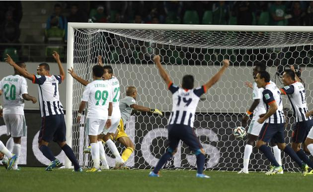 Cesar Delgado of Mexico's Monterrey celebrates his team's goal against Morocco's Raja Casablanca during their FIFA Club World Cup soccer match in Agadir