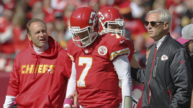 Kansas City Chiefs quarterback Matt Cassel (7) walks off the field with trainers during the second half of an NFL football game against the Baltimore Ravens at Arrowhead Stadium in Kansas City, Mo., Sunday, Oct. 7, 2012. The Ravens defeated the Chiefs 9-6. (AP Photo/Colin E. Braley)
