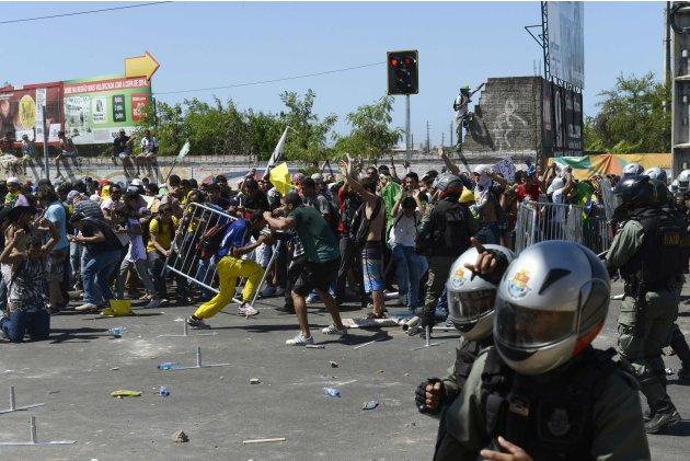 Demonstrators confront Brazilian riot police as they attempt to approach Estadio Castelao during the Confederations Cup soccer match between Brazil and Mexico, in Fortaleza