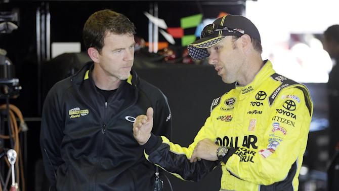 Driver Matt Kenseth, right, talks with crew chief Jason Ratcliff in the garage after a qualifying session for the NASCAR Sprint Cup series auto race at Michigan International Speedway in Brooklyn, Mich., Saturday, June 14, 2014