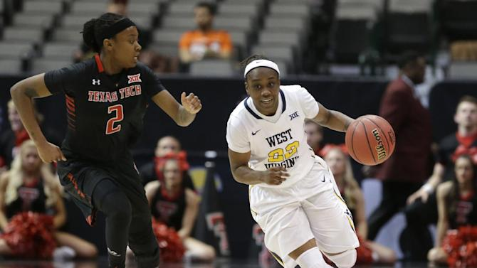 West Virginia guard Linda Stepney (22) drives against Texas Tech guard Ivonne CookTaylor (2) during the second half of an NCAA college basketball game in the first round of the Big 12 Conference tournament Friday, March 6, 2015, in Dallas. (AP Photo/LM Otero)
