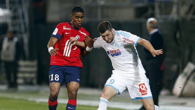 Olympique Marseille's Gignac challenges Beria of Lille during their French Ligue 1 soccer match in Marseille