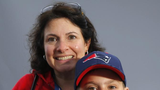 New England Patriots fan Connie Guttierez and her eleven year-old son Frankie pose for a portrait in Phoenix