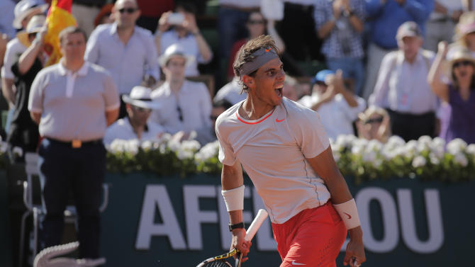 Spain's Rafael Nadal smiles as he defeats Serbia's Novak Djokovic during their semifinal match of the French Open tennis tournament at the Roland Garros stadium Friday, June 7, 2013 in Paris. (AP Photo/Christophe Ena)