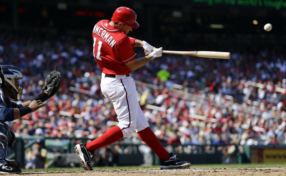 Washington Nationals' Ryan Zimmerman hits a three-run home run during the fourth inning of a baseball game against the Milwaukee Brewers at Nationals Park Saturday, Sept. 22, 2012, in Washington. The Nationals won 10-4. (AP Photo/Alex Brandon)