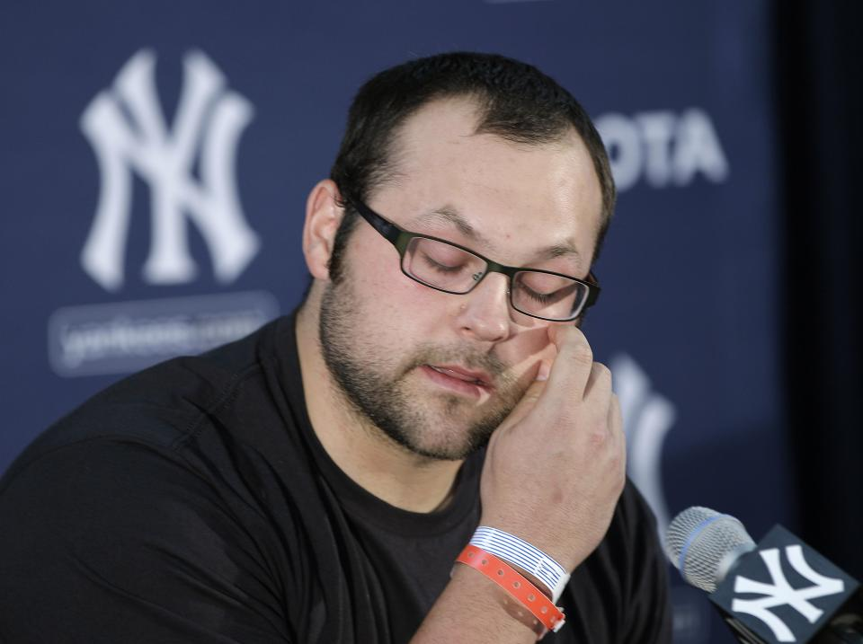 New York Yankees relief pitcher Joba Chamberlain gets emotional as he speaks about his relationship with his son, during a news conference in Tampa, Fla., Tuesday, March 27, 2012. Chamberlain injured his right ankle while jumping on a trampoline with his son. (AP Photo/Kathy Willens)