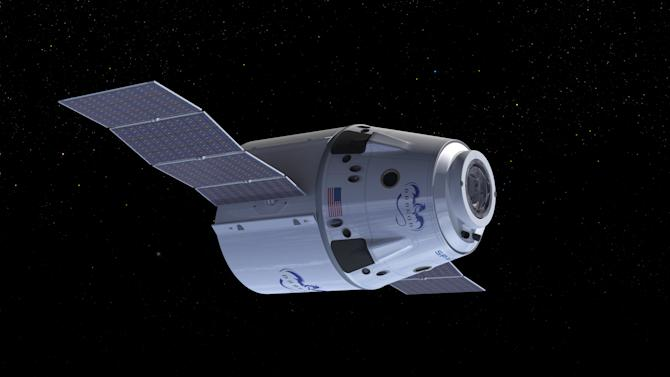 This undated computer generated illustration provided by SpaceX shows a Dragon Crew spacecraft in Earth orbit showing solar panels in the process of deploying. NASA has picked three aerospace companies to build small rocketships to take astronauts to the International Space Station. This is the third phase of NASA's efforts to get private space companies to take over the job of the now-retired space shuttle. The space agency is giving them more than $1.1 billion. Two of three ships are capsules like in the Apollo era and the third is a lifting body that is closer in design to the space shuttle. (AP Photo/SpaceX)