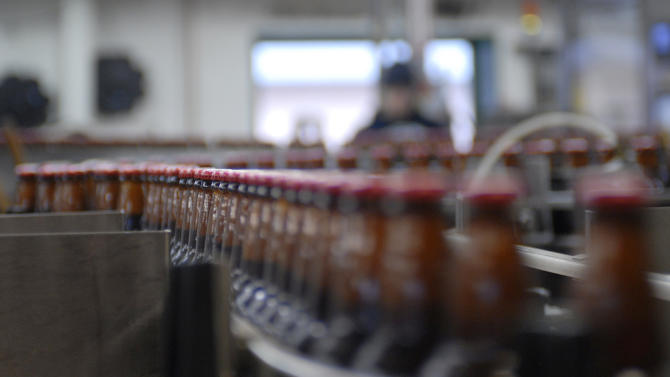 This photo taken Jan 23, 2013, in Juneau, Alaska, shows the bottling line inside the Alaskan Brewing Co. The brewery has installed a unique boiler system that burns the company's dried, spent grain or waste accumulated by the brewing process into steam which powers the majority of the plant's operations. (AP Photo/Joshua Berlinger)