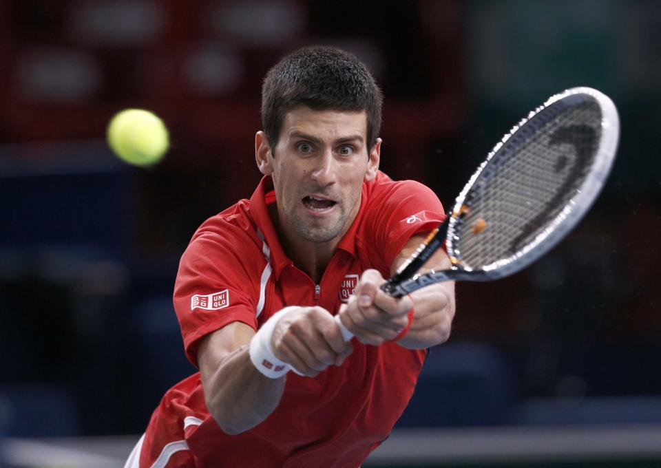 Novak Djokovic of Serbia returns the ball to Sam Querrey of the U.S. during their match at the Paris Tennis Masters tournament, Wednesday, Oct. 31, 2012. (AP Photo/Christophe Ena)