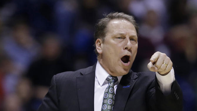 Michigan State head coach Tom Izzo directs his team during the first half of a regional semifinal against Duke in the NCAA college basketball tournament, Friday, March 29, 2013, in Indianapolis. (AP Photo/Darron Cummings)
