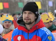 Russian athlete Alexander Tretyakov, the winner of men's skeleton competition at the Bobsleigh and Skeleton World Championships 2013 in St. Moritz, attends the 8th annual comic tobogganing competition, dedicated to the upcoming All Fools' Day and the end of a winter sports season, at the Vetluzhanka ski stadium on the suburbs of Russia's Siberian city of Krasnoyarsk, March 30, 2013. About 80 participants competed in tobogganing down from a snow slope on basins, baths, refrigerators and other items, according to organizers. REUTERS/Ilya Naymushin (RUSSIA - Tags: SOCIETY SPORT SKELETON)