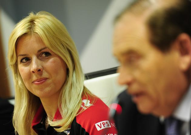 Formula One team Marussia driver  Maria De Villota of Spain looks to Auto Spanish Federation President Carlos Gracia during a press conference in Madrid on March 9, 2012.  AFP PHOTO/JAVIER SORIANO. (P