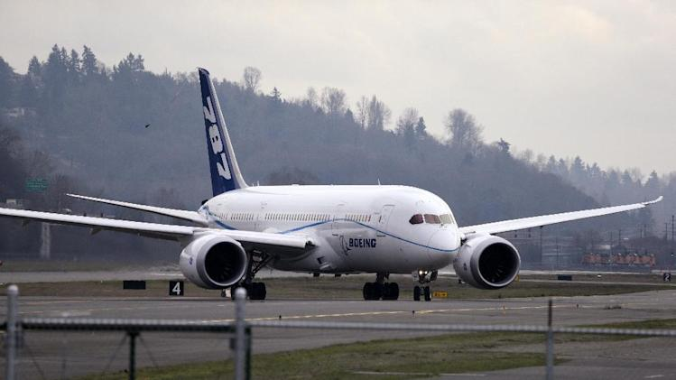 FILE - This Feb. 11, 2013 file photo shows a Boeing 787 jet taxing following a test flight, at Boeing Field, in Seattle. The Boeing Co. reports quarterly financial results before the market opens on Wednesday, April 24, 2013.(AP Photo/Elaine Thompson, File)
