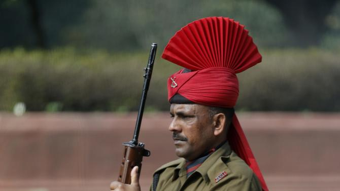 An Indian soldier in ceremonial dress stands at attention during U.S. President Barack Obama's visit to the Rashtrapati Bhavan presidential palace in New Delhi