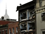 The Empire State Building towers in the background of an apartment building in Chelsea, New York City, with the facade broken off the morning after Sandy. The hammer blow dealt to New York by superstorm Sandy should raise the alarm for coastal mega-cities in Asia which are more exposed but less equipped to deal with such threats, experts said on Tuesday