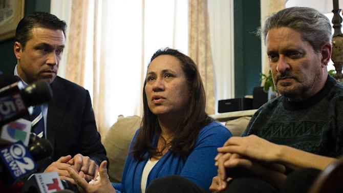 Betzaida Jimenez, mother of 33-year-old Sarai Sierra who was found dead on Saturday in Turkey, speaks during a news conference at a friend's home in Staten Island alongside Congressman Michael Grimm, left, and her husband Dennis on Monday Feb. 4, 2013, in New York. The New York City woman went missing while vacationing alone in Istanbul on Jan. 21, the day she was due to board her flight back home.   (AP Photo/John Minchillo)