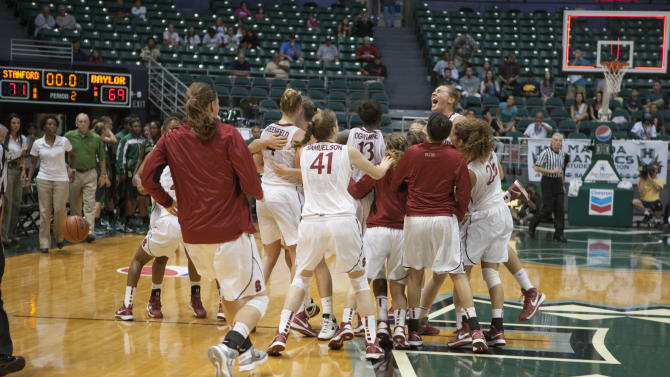 Stanford players celebrates after defeating Baylor 71-69 in an NCAA college basketball game Friday, Nov. 16, 2012 in Honolulu.  (AP Photo/Marco Garcia)