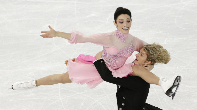 Russia holds lead in team event, Lipnitskaia soars