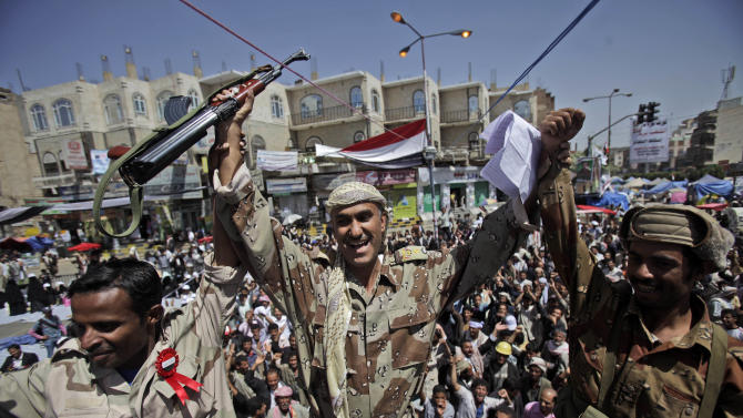 Yemeni army officers react as they join anti-government protestors demanding the resignation of Yemeni President Ali Abdullah Saleh, in Sanaa,Yemen, Monday, March 21, 2011. Three Yemeni army commanders, including a top general, defected Monday to the opposition calling for an end to President Ali Abdullah Saleh's rule, as army tanks and armored vehicles deployed in support of thousands protesting in the capital. With the defection, it appeared Saleh's support was eroding from every power base in the nation _ his own tribe called on him to step down, he fired his entire Cabinet ahead of what one government official said was a planned mass resignation, and his ambassador to the U.N. and human rights minister quit. (AP Photo/Muhammed Muheisen)