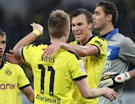 Dortmund&#39;s midfielder Kevin Grosskreutz (R) celebrates scoring the 2-1 with striker Marco Reus during the German first division Bundesliga football match against Hoffenheim in Sinsheim southwestern Germany, on December 16, 2012. Dortmund moved back up to third in the Bundesliga with a 3-1 win at strugglers Hoffenheim