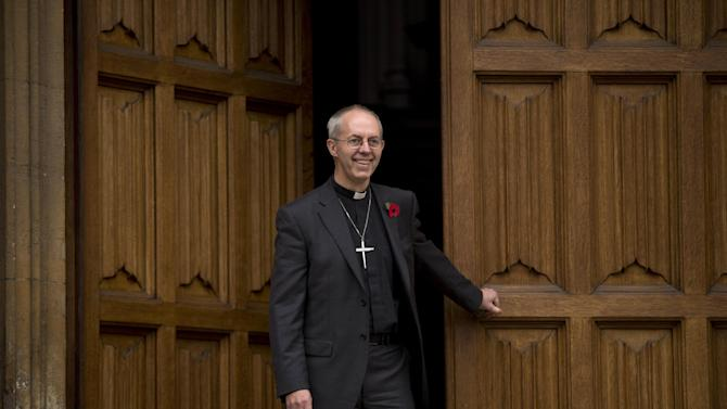 Britain's bishop of Durham Justin Welby poses for photographers after a news conference following the announcement he will become the next archbishop of Canterbury at Lambeth Palace in London, Friday, Nov. 9, 2012. The former oil executive with experience in conflict resolution has been chosen to lead a global Anglican Communion riven by sharply divided views on gay people and their place in the church. Britain's Prime Minister David Cameron announced Friday that Justin Welby, 56, a fast-rising priest with only a year's experience as a bishop, had been picked to succeed Rowan Williams as archbishop of Canterbury, spiritual leader of the world's 77 million Anglicans. (AP Photo/Matt Dunham)