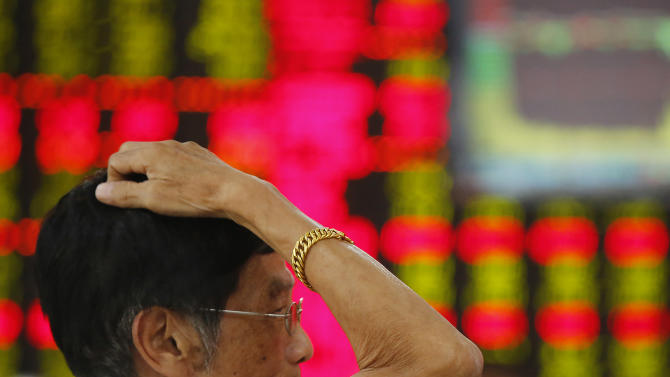 An investor looks at the stock price monitor at a private securities company Friday Aug. 23, 2013 in Shanghai, China. Asian stock markets rose Friday after encouraging economic data from China and Europe raised hopes that a global economic recovery was underway. (AP Photo)