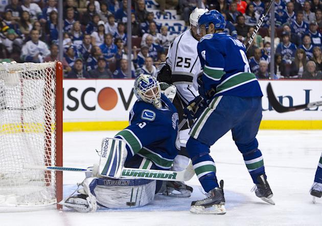 Goalie Cory Schneider #35 Of The Vancouver Canucks Stops Willie Mitchell #33 Of The Los Angeles Kings (not Picutred) Getty Images