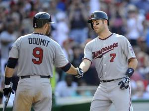 Doumit singles in run in 11th, Twins top Nats 4-3