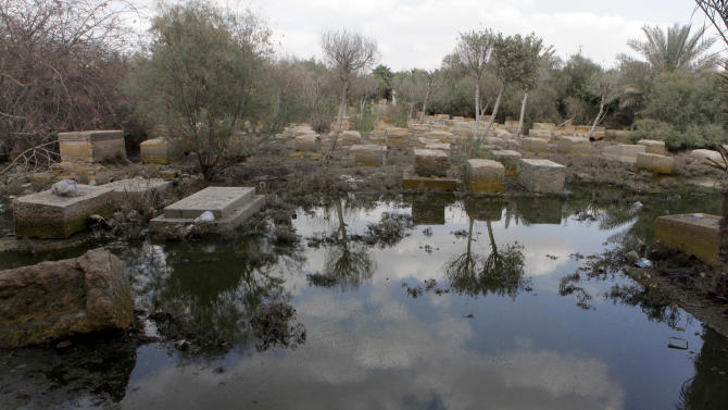 A general view of damaged tombs and fetid water at the Jewish cemetery, in Cairo, Egypt, Thursday, April 18, 2013. The leader of Egypt's dwindling and aging Jewish community, known for her tireless work preserving synagogues and a once-sprawling Jewish cemetery, died Saturday at the age of 82. Carmen Weinstein was buried Thursday in the Bassatine cemetery she herself worked to save since 1978. It is the only Jewish cemetery left in Cairo and is the largest in Egypt. The transformation of Bassatine mirrors the dramatic changes Egypt has undergone as its population skyrocketed and poverty grew. Parts of Bassatine were turned into a garbage dump, while another area was seized by antiquities' officials. Weinstein was able to preserve a small area as a Jewish cemetery.  (AP Photo/Amr Nabil)