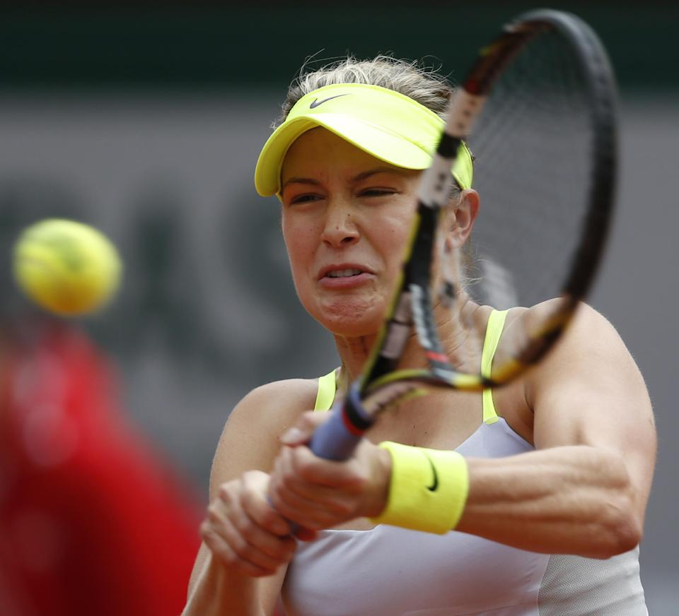 Canada's Eugenie Bouchard returns against Russia's Maria Sharapova in their second round match at the French Open tennis tournament, at Roland Garros stadium in Paris, Thursday, May 30, 2013. (AP Photo/Petr David Josek)