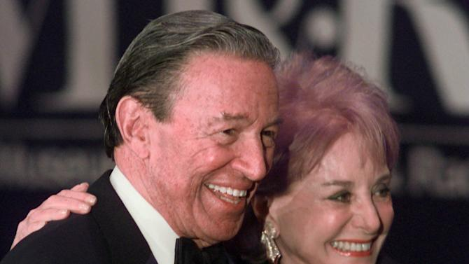 """FILE - In this Feb. 4, 1999 file photo, Barbara Walters and Mike Wallace pose for photographers before the start of a gala for The Museum of Television and Radio in New York. Wallace, the dogged, merciless reporter and interviewer who took on politicians, celebrities and other public figures in a 60-year career highlighted by the on-air confrontations that helped make """"60 Minutes"""" the most successful primetime television news program ever, has died. He was 93. (AP Photo/Mark Lennihan, File)"""