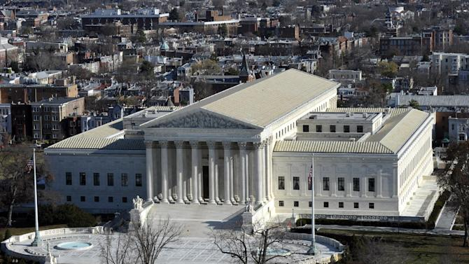 In this Dec. 19, 2013 file photo, a view of the Supreme Court can be seen from the view from near the top of the Capitol Dome on Capitol Hill in Washington. The Supreme Court hears arguments Monday in a clash between President Obama and Senate Republicans over the power granted the president in the Constitution to make temporary appointments to fill high-level positions. (AP Photo/Susan Walsh)