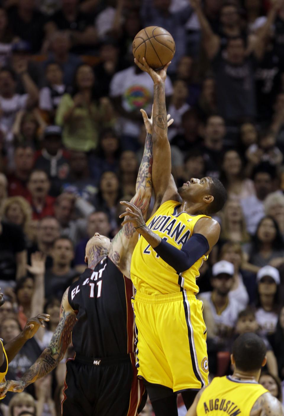 Indiana Pacers' Paul George (24) recovers a rebound over Miami Heat's Chris Andersen (11) during the first half of an NBA basketball game in Miami, Sunday, March 10, 2013. (AP Photo/Alan Diaz)
