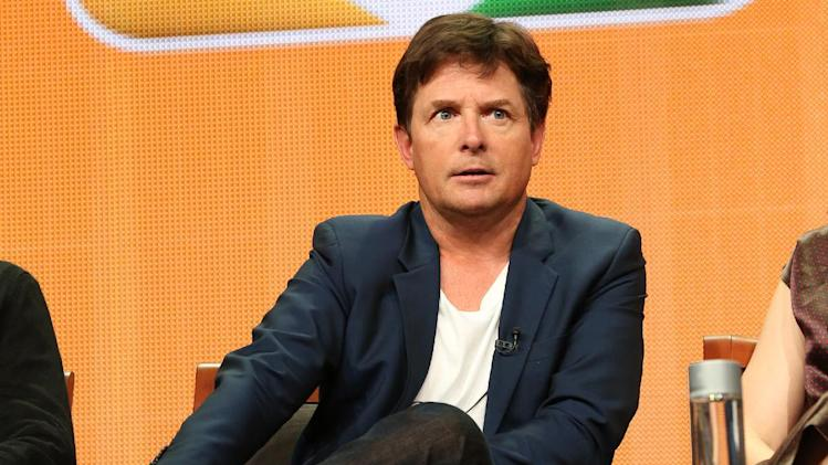"FILE - This July 27, 2013 file publicity image released by NBC shows actor Michael J. Fox from the ""The Michael J. Fox Show"" panel during the NBCUniversal Press Tour in Beverly Hills, Calif. Fox will star as Mike Henry, a former local NBC newscaster with Parkinson's. (AP Photo/NBC, Chris Haston)"