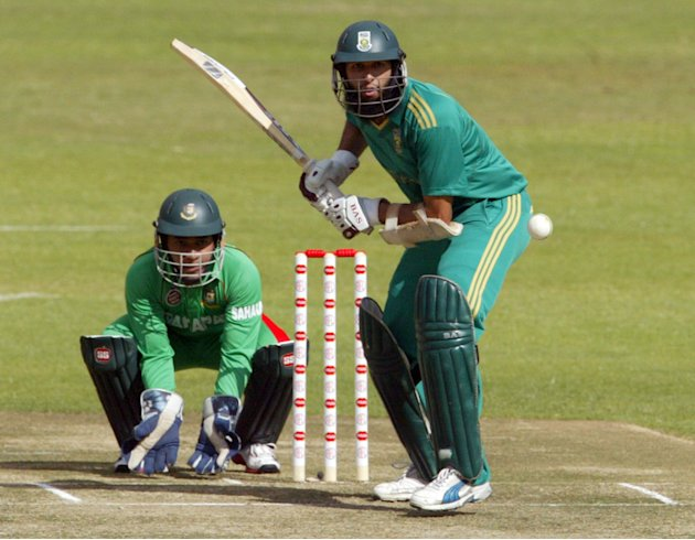 South African captain Hashim Amla (R) ba